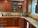Oversized cherry wood cabinetry - 2504 VALLEY DR, ALEXANDRIA