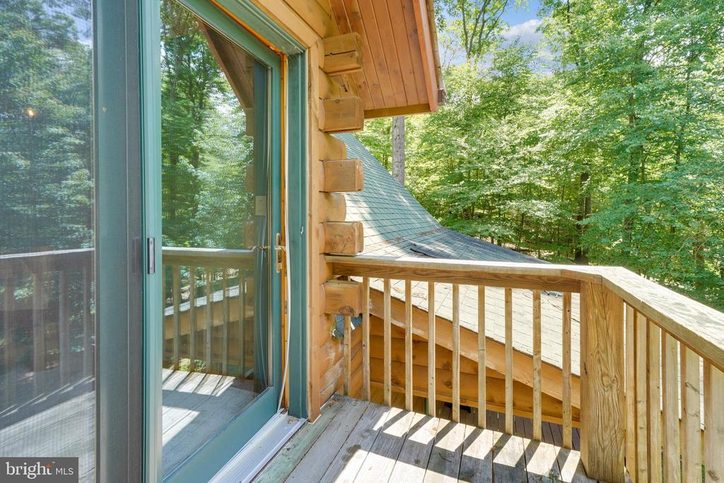 Sliding glass doors off of the master bedroom. - 13533 CATOCTIN HOLLOW RD, THURMONT