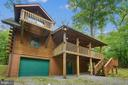 The balconies overlook 6+ acres of trees! - 13533 CATOCTIN HOLLOW RD, THURMONT