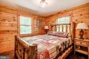 Main level bedroom with a cabin feel! - 13533 CATOCTIN HOLLOW RD, THURMONT