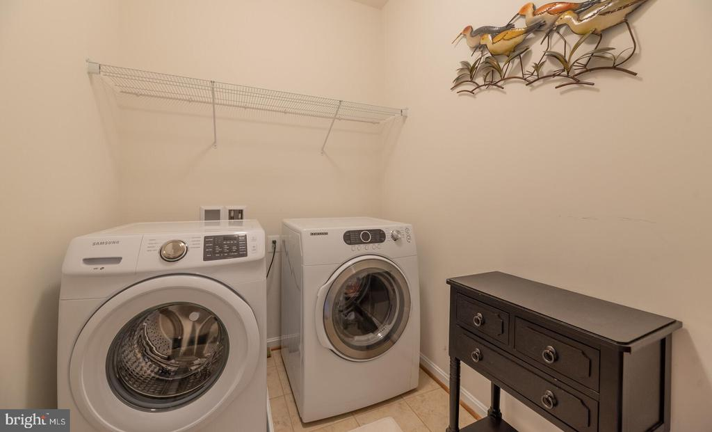 Upper level large laundry room with front loaders. - 19441 COPPERMINE SQ, LEESBURG