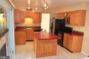 Kitchen with island  seating for 2 - 404 GREEAR PL, HERNDON