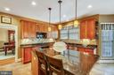 Gourmet center isle kitchen has granite counters - 9704 WOODFIELD CT, NEW MARKET