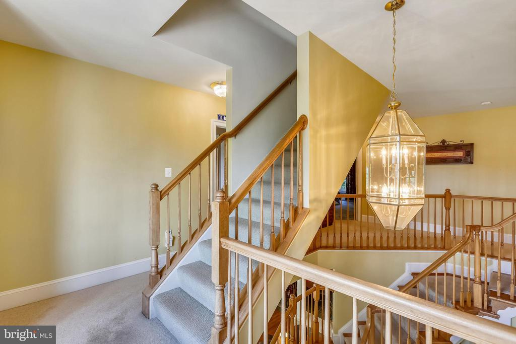 Stairs from the 3rd level leads to the 4th level - 9704 WOODFIELD CT, NEW MARKET