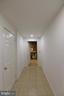 basement hallway to workshop and laundry - 720 DONALDSON LN SW, LEESBURG