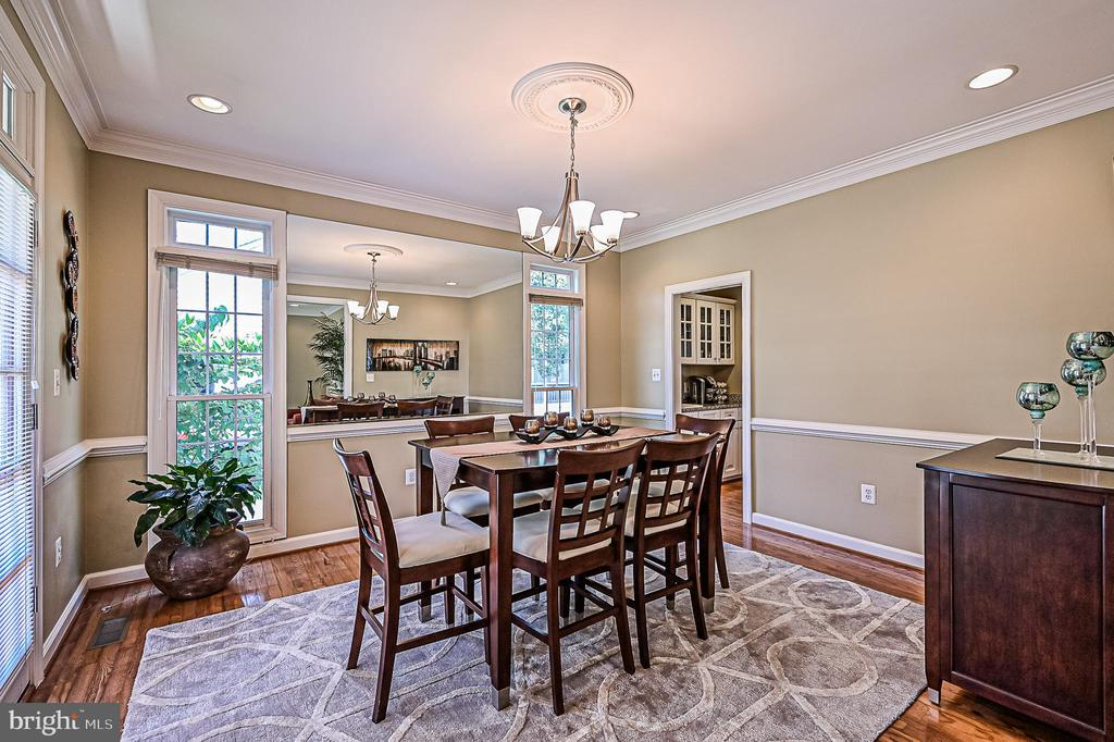 Formal Dining Room w/ Chair Rail & Crown Moldings - 26124 TALAMORE DR, CHANTILLY