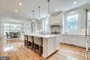 Kitchen island with pendant lighting - 6221 ARKENDALE RD, ALEXANDRIA