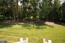 View of Tree Lined Back Yard - 1057 MARMION DR, HERNDON