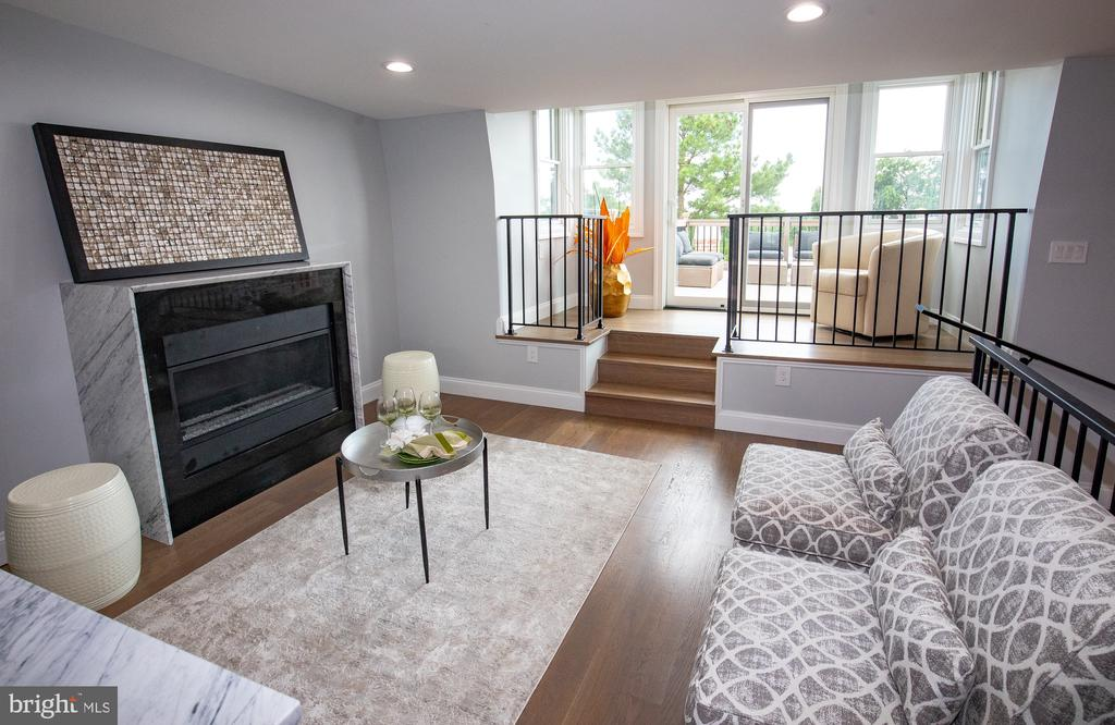 Marbled gas fireplace in entertainment/family room - 50 BRYANT ST NW, WASHINGTON