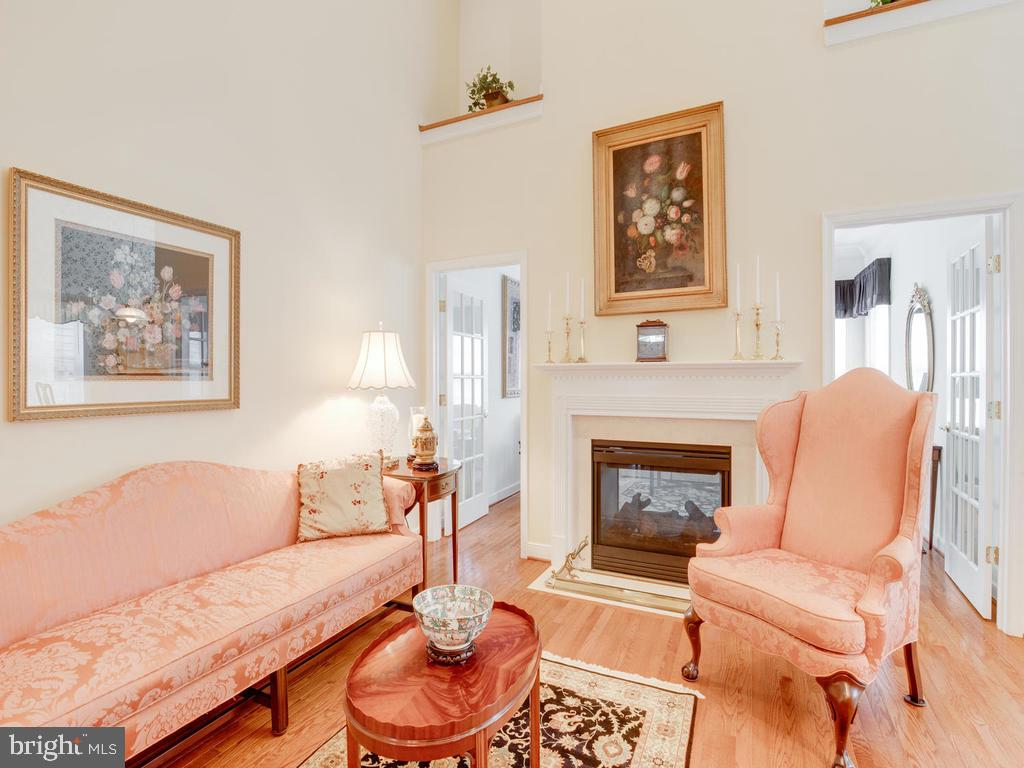 Two-Sided Gas Fireplace, leading to Sun Room - 8853 WARM GRANITE DR #35, COLUMBIA