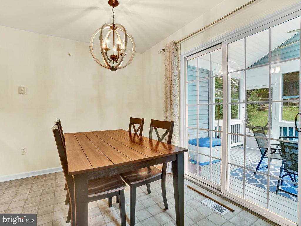 Sliding doors to enclosed porch from dining area - 318 E D ST, BRUNSWICK