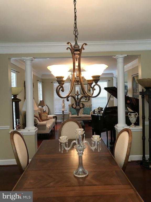 Dining room separated with columns - 11079 SANANDREW DR, NEW MARKET
