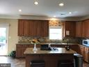 Kitchen with Granite Counters and 42