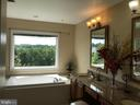 Master bath with large Jacuzzi  soaking tub - 11079 SANANDREW DR, NEW MARKET