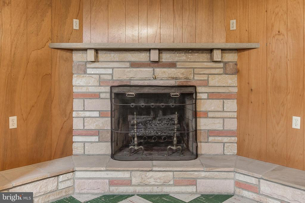Fireplace in finished basement - 215 BROAD ST, MIDDLETOWN