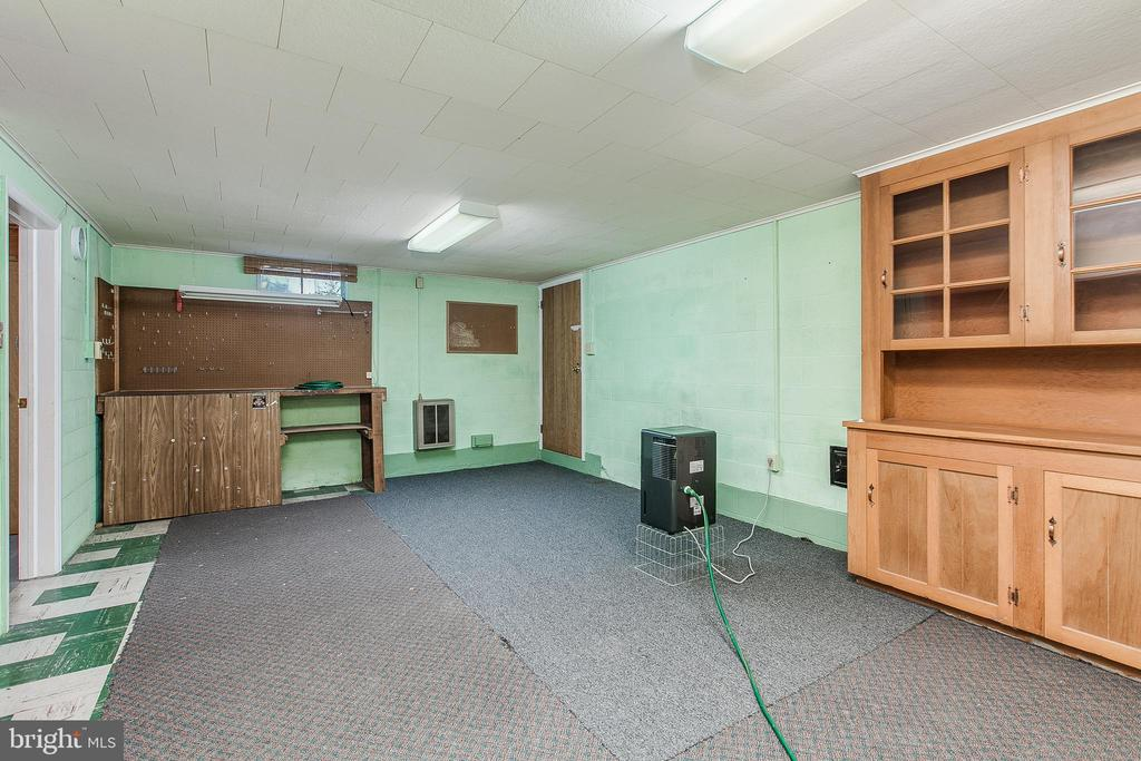 Basement with built-in hutch and exit to garage - 215 BROAD ST, MIDDLETOWN