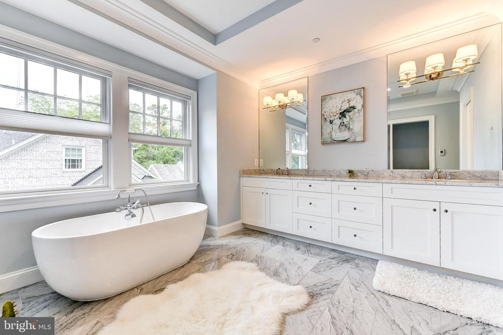 Owner's spa bathroom with marble finishes - 4522 CHELTENHAM DR, BETHESDA