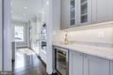 Butler's pantry with wine chiller - 4522 CHELTENHAM DR, BETHESDA