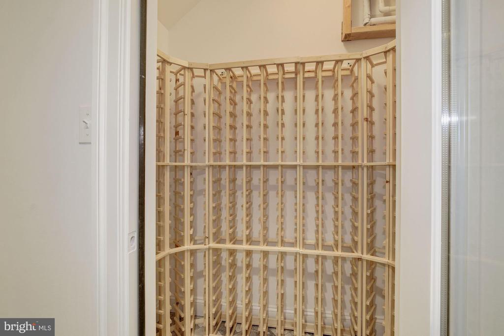 Wine closet located on the lower level - 4522 CHELTENHAM DR, BETHESDA