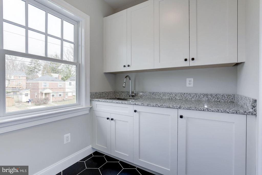 Excellent storage and sink in laundry room - 4522 CHELTENHAM DR, BETHESDA