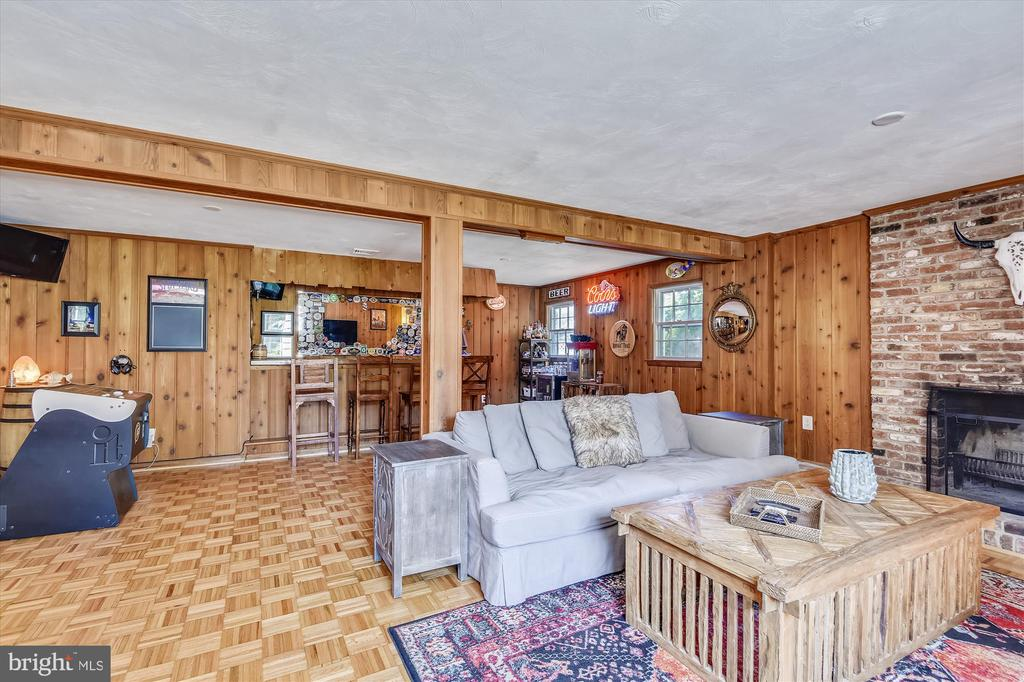 Open entertainment space in downstairs rec room - 9031 GREYLOCK ST, ALEXANDRIA