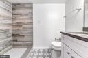 En suite full bath with tile shower - 4401 GARRISON ST NW, WASHINGTON