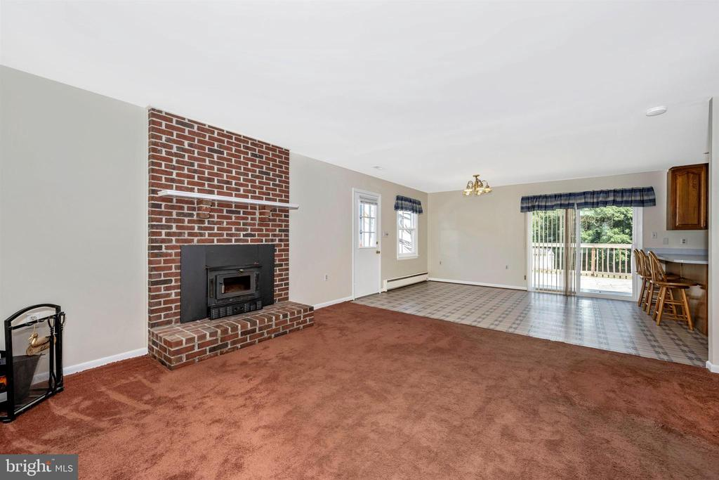 Living room with fireplace w/woodstove insert - 3495 ADGATE DR, IJAMSVILLE
