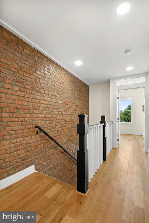 Second Floor Landing with Exposed Brick - 1734 INDEPENDENCE AVE SE, WASHINGTON