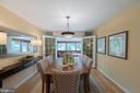 Dining room opens to 3 season room - 505 WOODSHIRE LN, HERNDON