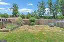 Privacy fenced back yard with planter boxes. - 48 HUNTING CREEK LN, STAFFORD
