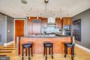 Long bar is great for entertaining - 2001 15TH ST N #1104, ARLINGTON