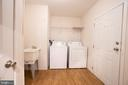 Laundry Room with Wash Tub with Door to Backyard - 11080 EDGEHILL ACADEMY RD, WOODFORD