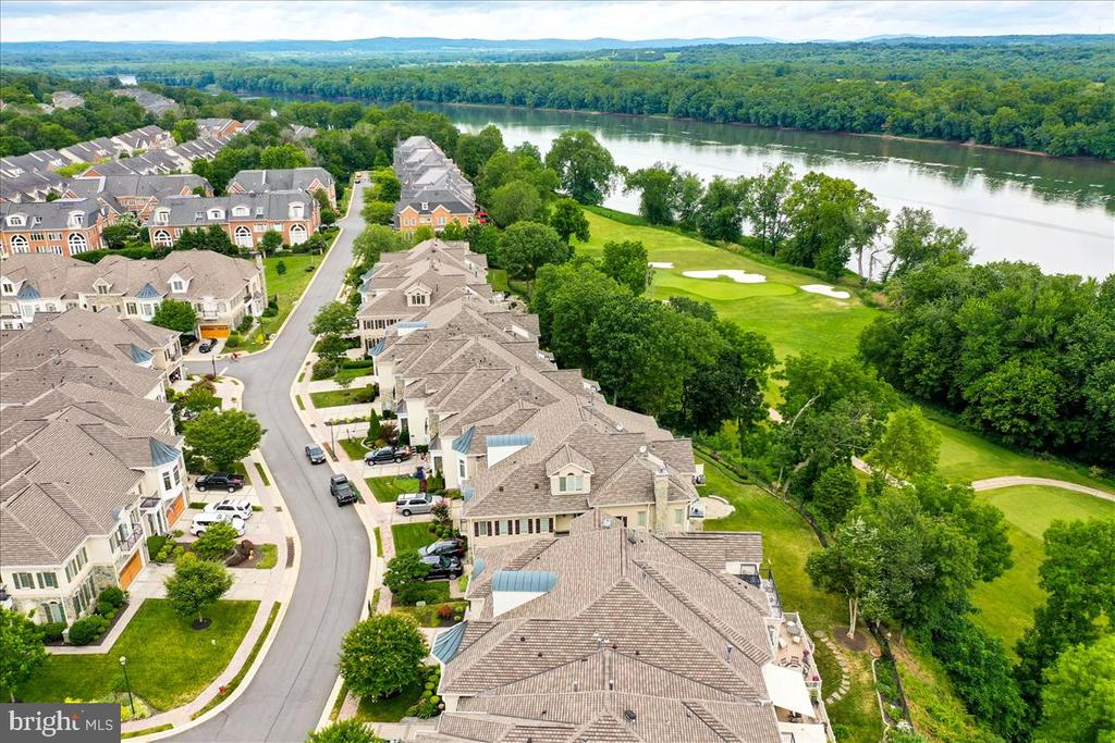 Street view with golf course and river beyond - 18356 FAIRWAY OAKS SQ, LEESBURG