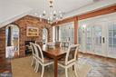 Dining area with double sided gas fireplace - 510 HAMMONDS CT, ALEXANDRIA