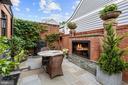 Enclosed bluestone patio w/gas fireplace - 510 HAMMONDS CT, ALEXANDRIA