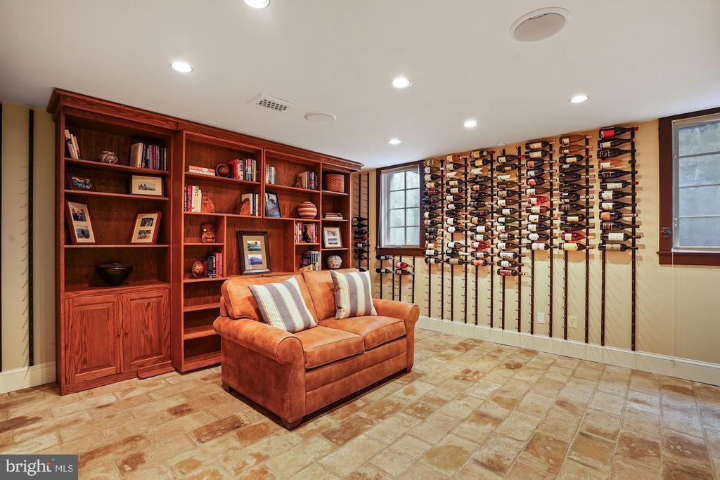 Lower rec room w/ Murphy bed behind bookshelves - 510 HAMMONDS CT, ALEXANDRIA