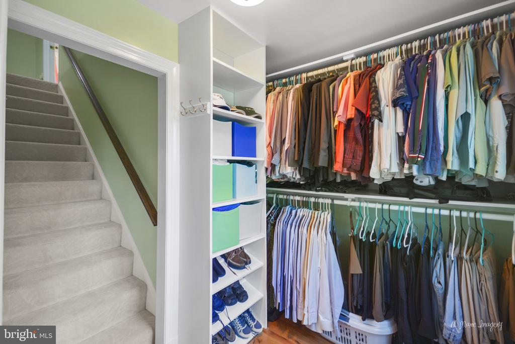 Walk in closet in master leading to a third floor. - 10095 DUDLEY DR, IJAMSVILLE