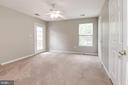 Master bedroom with door to patio - 631 CONSTELLATION SQ SE #A, LEESBURG
