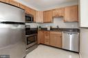 Granite and stainless steel appliances in kitchen - 631 CONSTELLATION SQ SE #A, LEESBURG