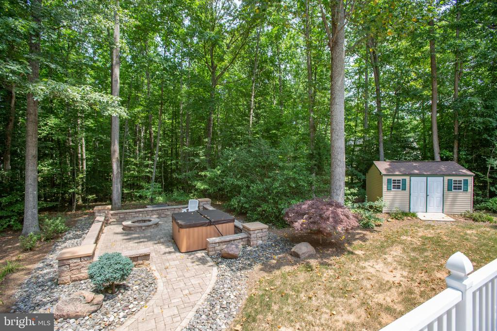 View of hot tub & patio from the deck - 9101 SNOWY EGRET CT, SPOTSYLVANIA