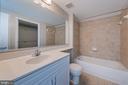 Large bathroom with tile throughout - 555 MASSACHUSETTS AVE NW #202, WASHINGTON