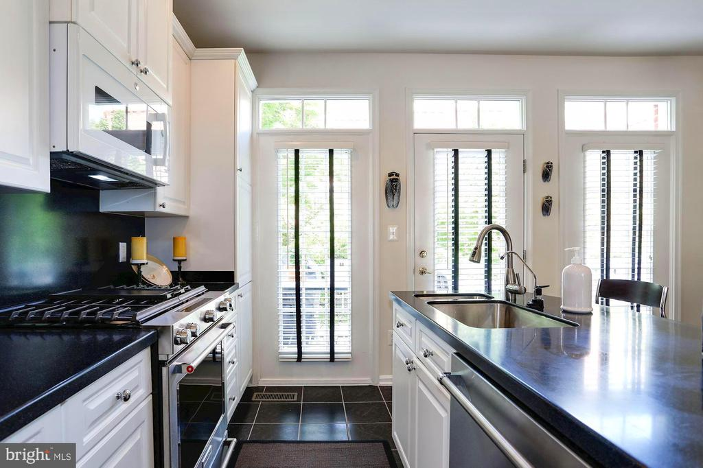 Bright Kitchen Wall with Exit to Rear Deck - 12197 CHANCERY STATION CIR, RESTON
