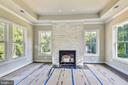 Split faced marble accenting sitting rm fireplace - 9524 LEEMAY ST, VIENNA