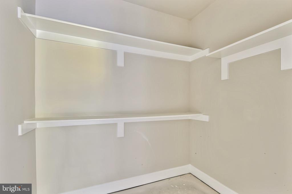 Walk-in closet off lower level bedroom - 9524 LEEMAY ST, VIENNA