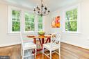 Large dining space opens to kitchen - 4401 GARRISON ST NW, WASHINGTON