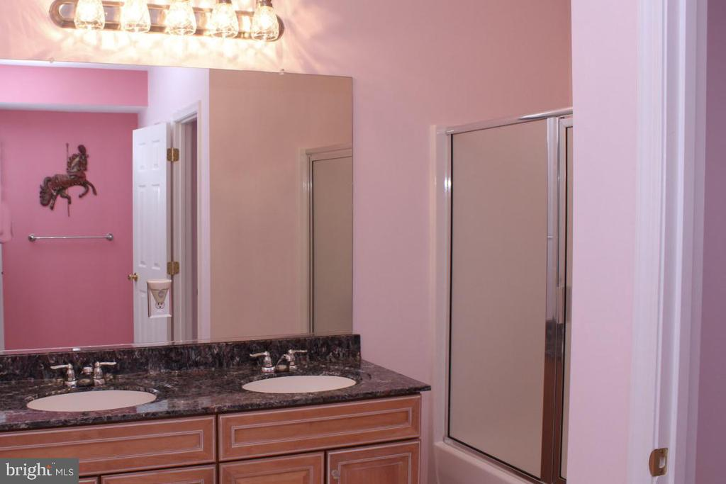 lower level full bath with double vanity - 3220 LACROSSE CT, DUNKIRK