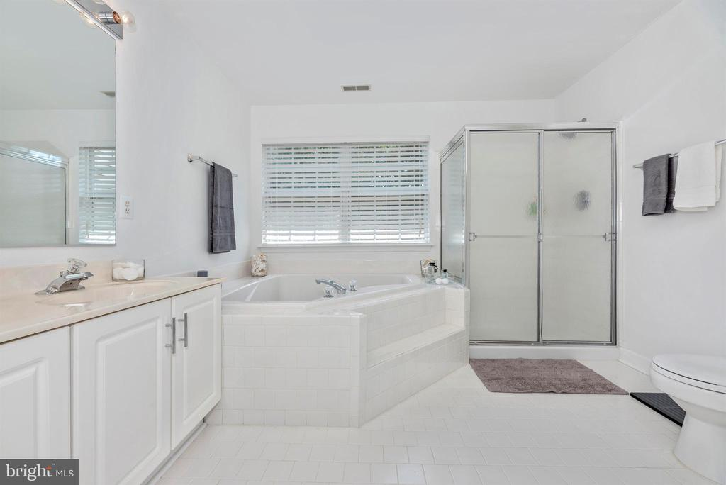 Master bathroom with soaking tub and stand shower. - 5835 RIVER OAKS CT, FREDERICK