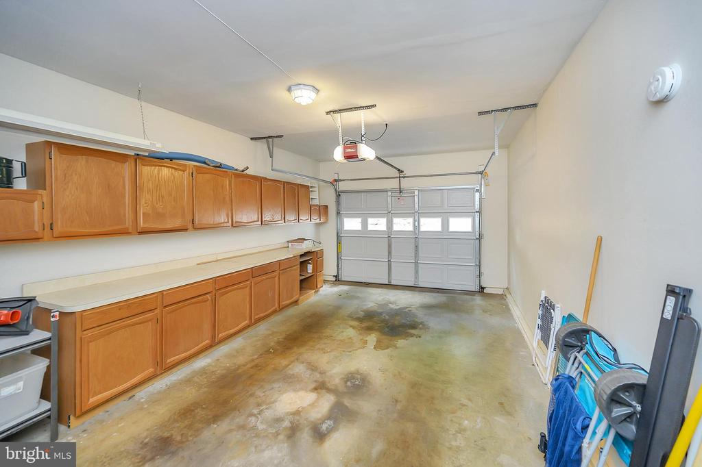 Garage with cabinets for storage - 109 INDIAN HILLS RD, LOCUST GROVE