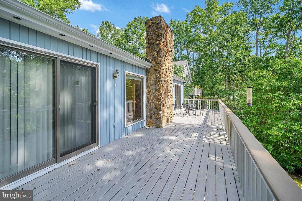 Deck that runs the width of the house - 109 INDIAN HILLS RD, LOCUST GROVE