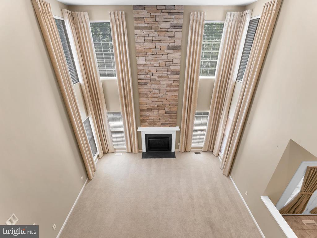 View from 2 story hallway down to family & kitchen - 358 SUGARLAND MEADOW DR, HERNDON